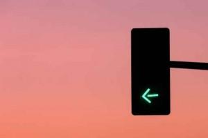 Green light arrow on traffic road sign